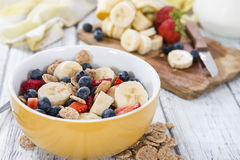 Portion of Cornflakes with fresh Fruits Stock Photos