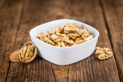 Portion of Cracked Walnuts on wooden background selective focus royalty free stock photo