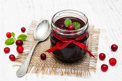 Portion of cranberry jam with fresh fruits Stock Photos