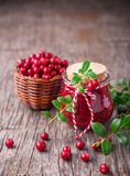 Portion of Cranberry Jam with fresh fruits Royalty Free Stock Photo