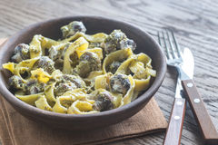 Portion of creamy mushroom pasta with pesto Royalty Free Stock Images