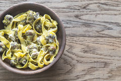 Portion of creamy mushroom pasta with pesto Royalty Free Stock Image