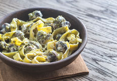 Portion of creamy mushroom pasta with pesto Stock Photos