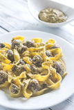 Portion of creamy mushroom pasta with pesto Stock Images