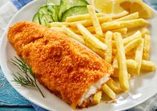 Portion of crispy fish with chips Royalty Free Stock Photo