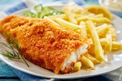Portion of crispy fish with french fries Royalty Free Stock Images