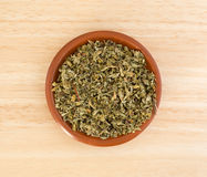 Portion of damiana leaf in a small bowl. Top view of a portion of damiana leaf in a small bowl on a wood counter top Stock Image