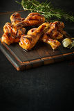Portion of delicious marinated spicy chicken legs royalty free stock image