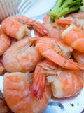 Portion of delicious shrimps with broccoli. Portion of delicious boiled shrimps with broccoli Royalty Free Stock Images