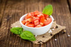 Portion of Diced Tomatoes. Diced Tomatoes on a vintage background as detailed close-up shot selective focus stock photos