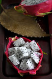 Portion of dragon fruit on tray Stock Image