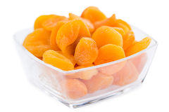 Portion of Dried Apricots isolated on white Stock Photo