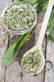Portion of dried Ramson on a wooden spoon Stock Photography