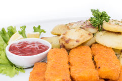 Portion of Fish Fingers with fried Potatoes Stock Image
