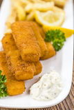 Portion of Fish Fingers selective focus Stock Photo