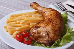 Portion of French fries with chicken leg close-up� Royalty Free Stock Photography