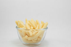 Portion of French fries (fried potatoes) in bowl. On white background Royalty Free Stock Photography