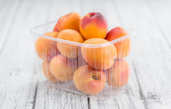 Portion of Fresh Apricots on wooden background & x28;selective focus& x29;. Apricots on an old wooden table as detailed close-up shot & x28;selective focus& x29 Stock Photo