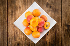 Portion of Fresh Apricots on wooden background selective focus. Apricots on an old wooden table as detailed close-up shot selective focus Stock Image