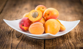 Portion of Fresh Apricots on wooden background selective focus. Apricots on an old wooden table as detailed close-up shot selective focus Stock Photography