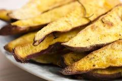 Portion of fresh baked sweet potato wedges Stock Image