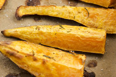 Portion of fresh baked sweet potato wedges Royalty Free Stock Images