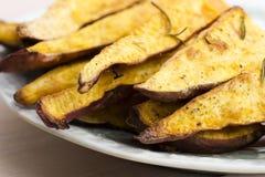 Portion of fresh baked sweet potato wedges Stock Photos