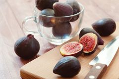 Portion of fresh Figs on vintage wooden background Royalty Free Stock Photo