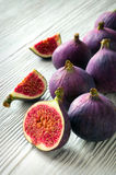 Portion of fresh Figs on wooden background Stock Images