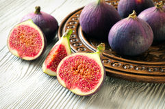 Portion of fresh Figs on wooden background Stock Photo