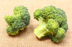 Portion of fresh green broccoli on jute canvas Royalty Free Stock Image