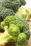 Portion of fresh green broccoli on jute canvas Royalty Free Stock Images