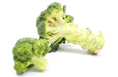 Portion of fresh green broccoli. White background Stock Photos