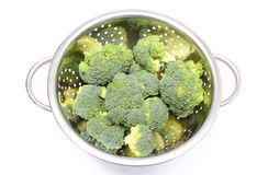 Portion of fresh green broccoli. White background Royalty Free Stock Photography
