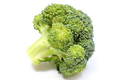 Portion of fresh green broccoli. White background Royalty Free Stock Photo