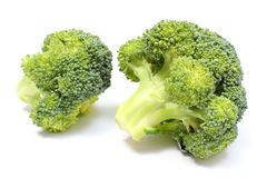 Portion of fresh green broccoli. White background Stock Photo