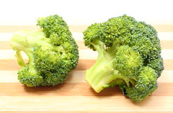 Portion of fresh green broccoli on wooden cutting board Royalty Free Stock Images