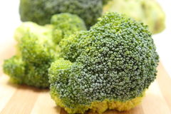 Portion of fresh green broccoli on wooden cutting board Royalty Free Stock Photo
