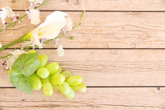 Portion of fresh Green Grapes. On vintage wooden background Royalty Free Stock Images