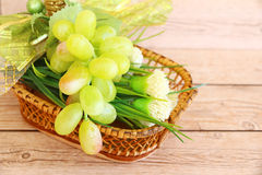 Portion of fresh Green Grapes. On vintage wooden background Stock Photos