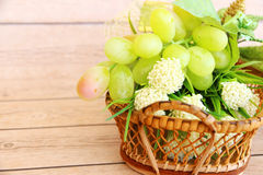 Portion of fresh Green Grapes. On vintage wooden background Royalty Free Stock Photography