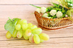 Portion of fresh Green Grapes. On vintage wooden background Royalty Free Stock Image