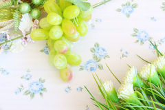 Portion of fresh Green Grapes. On vintage wooden background Stock Images