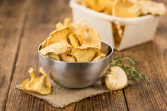 Portion of fresh harvested Chanterelles on wooden background. As detailed close-up shot selective focus Royalty Free Stock Image