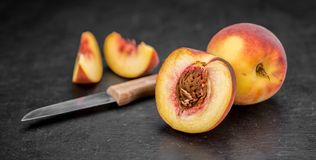 Portion of Fresh Peaches on a slate slab Royalty Free Stock Photography