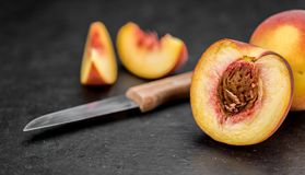 Portion of Fresh Peaches on a slate slab Stock Photos