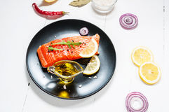 Portion of fresh salmon fillet with aromatic herbs, spices and v Stock Photo