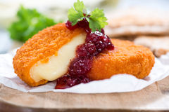 Portion of fried Camembert. (selective focus) on a wooden table Royalty Free Stock Photos
