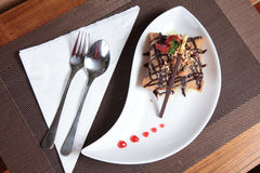 Portion of fried ice cream cake dessert. Photograph of portion of fried ice cream cake dessert on restaurant table Stock Image