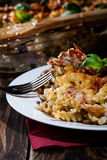 Portion of fusilli pasta casseroles, sausages and zucchini Royalty Free Stock Images